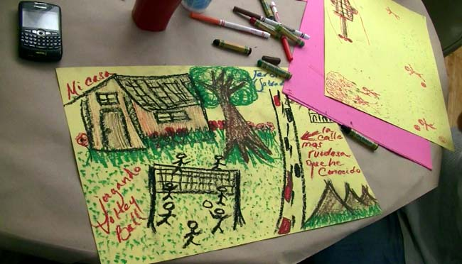 Community organizer Jeronimo, draws a picture of his childhood home, which was the reason for his perilous journey to the United States.